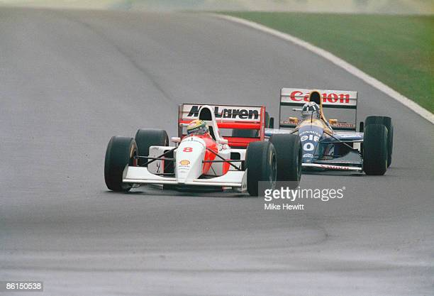 Brazilian racing driver Ayrton Senna in a McLarenCosworth leads Damon Hill's WilliamsRenault during the European Grand Prix at Donnington Park 11th...
