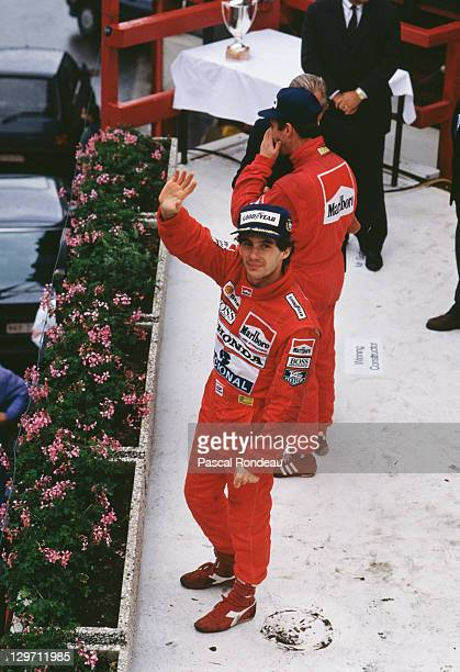Brazilian racing driver Ayrton Senna waves from the podium after winning the Belgian Grand Prix at the Spa circuit Belgium 27th August 1989