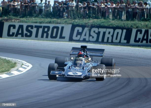Brazilian racing driver Emerson Fittipaldi drives the John Player Team Lotus Lotus 72D Ford V8 to finish in first place to win the 1972 British Grand...