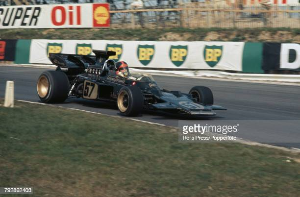 Brazilian racing driver Emerson Fittipaldi drives the John Player Team Lotus Lotus 72D Ford V8 to finish in first place to win the 1972 Race of...