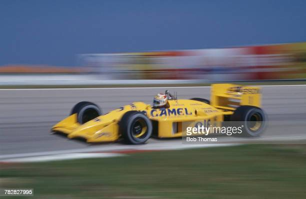 Brazilian racing driver Nelson Piquet drives the Camel Team Lotus Honda Lotus 100T Honda V6t to finish in 3rd place in the 1988 Brazilian Grand Prix...