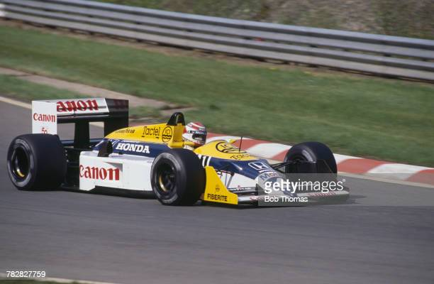 Brazilian racing driver Nelson Piquet drives the Canon Williams Team Williams FW11B Honda V6t in the 1987 Belgian Grand Prix at Circuit de...