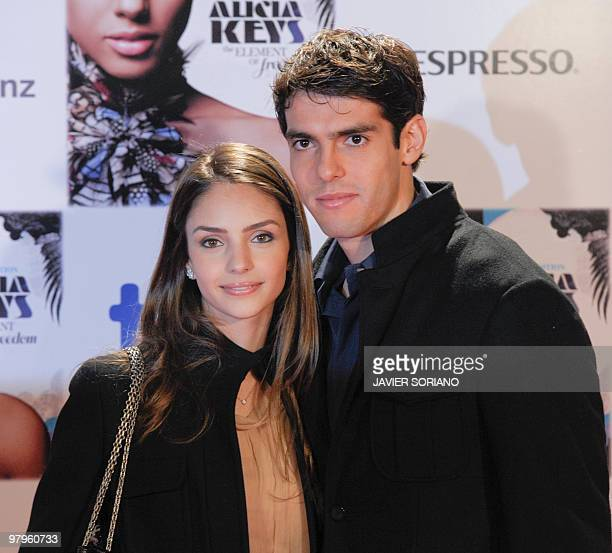 Brazilian Real Madrid's football player Kaka and his wife Caroline Celico pose before a showcase of US singer Alicia Keys to present her new album...