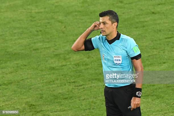 Brazilian referee Sandro Ricci gestures during the Russia 2018 World Cup Group D football match between Croatia and Nigeria at the Kaliningrad...