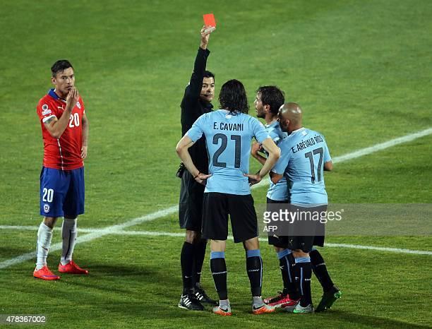 Brazilian referee Sandro Ricci shows the red card to Uruguay's forward Edinson Cavani during their 2015 Copa America football championship...