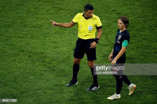 Brazilian referee Sandro Ricci speaks to Croatia's midfielder Luka Modric during the Russia 2018 World Cup quarterfinal football match between Russia...