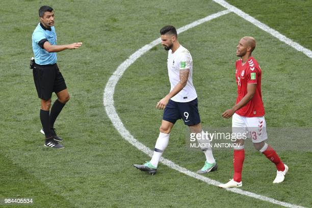 Brazilian referee Sandro Ricci speaks to France's forward Olivier Giroud during the Russia 2018 World Cup Group C football match between Denmark and...