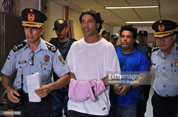 Brazilian retired football player Ronaldinho and his brother Roberto Assis arrive at Asuncion's Justice Palace to appear before a public prosecutor...