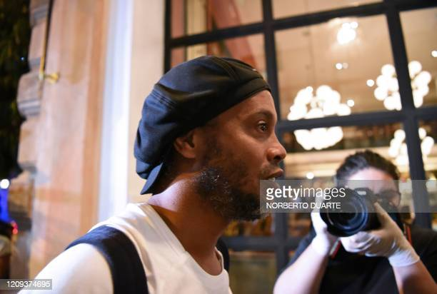 TOPSHOT Brazilian retired football player Ronaldinho arrives at a hotel in Asuncion where he and his brother will serve house arrest after a judge...