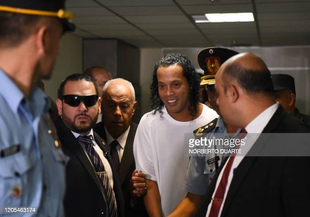 Brazilian retired football player Ronaldinho arrives at Asuncion's Justice Palace to testify about his irregular entry to the country in Asuncion on...
