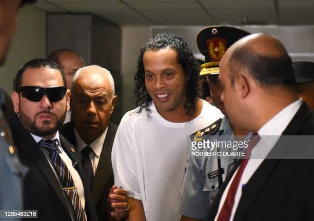 TOPSHOT Brazilian retired football player Ronaldinho arrives at Asuncion's Justice Palace to testify about his irregular entry to the country in...