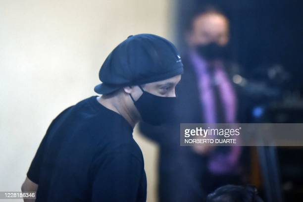 Brazilian retired football player Ronaldinho arrives for his hearing at the Asuncion's Justice Palace in Asuncion on August 24 2020 After six months...