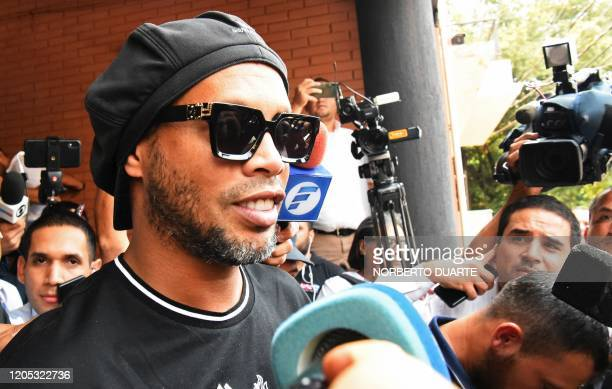 TOPSHOT Brazilian retired football player Ronaldinho leaves Asuncion's Prosecution after declaring about his irregular entry to the country in...