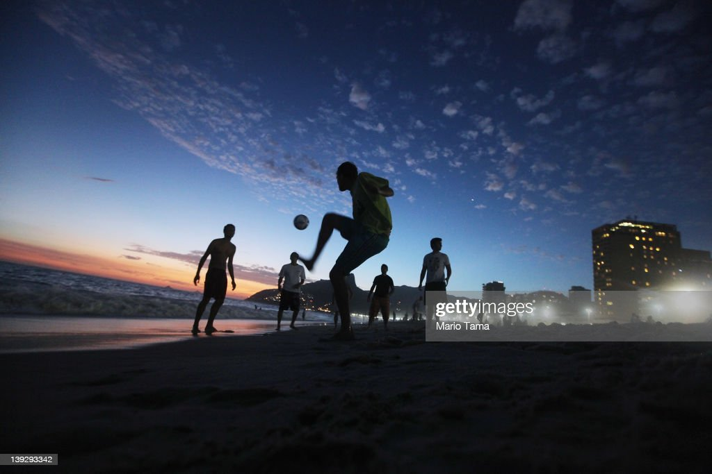 Brazilian revelers play soccer at sunset during Carnival celebrations along Ipanema beach on February 18, 2012 in Rio de Janiero, Brazil. Carnival is the grandest holiday in Brazil, annually drawing millions in raucous celebrations culminating on Fat Tuesday before the start of the Catholic season of Lent which begins on Ash Wednesday. Police strikes in Salvador and Rio de Janiero in recent weeks threatened Carnival and raised questions about the country's preparedness to host the upcoming 2014 World Cup and 2016 Summer Olympics.