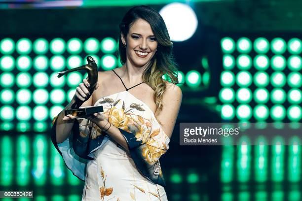 Brazilian Rhythmic Gymnastics competitor Natlia Gaudio is awarded during the ceremony of Brazil Olympics 2016 Awards at Cidade das Artes on March 29...