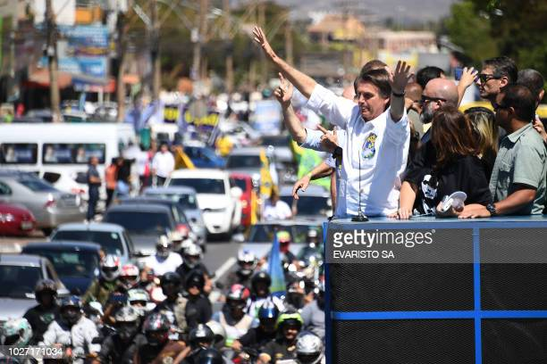 Brazilian rightwing presidential candidate Jair Bolsonaro gestures at the crowd during a campaign rally in the district of Ceilandia in Brasilia on...