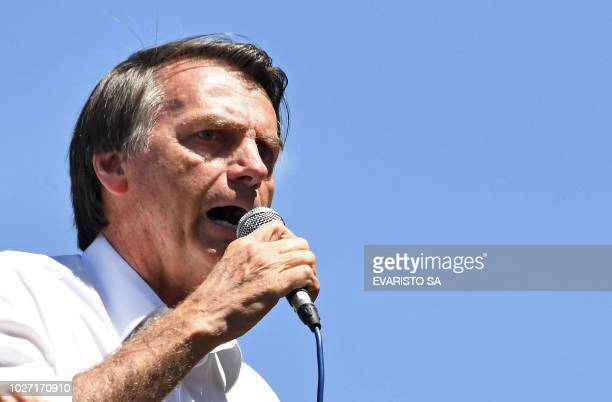Brazilian rightwing presidential candidate Jair Bolsonaro speaks during a campaign rally in the district of Ceilandia in Brasilia on September 5 2018...