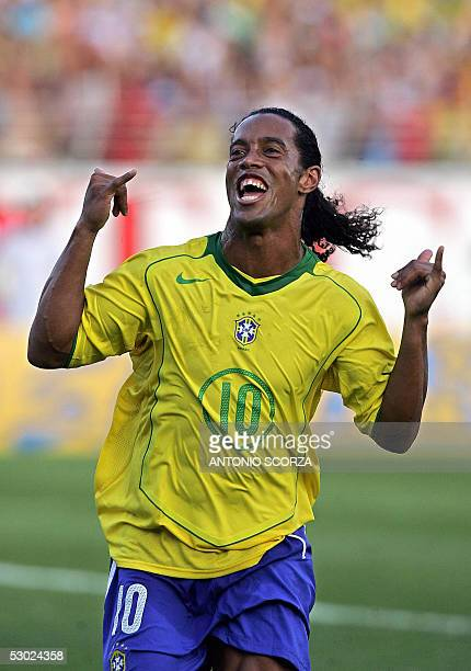 Brazilian Ronaldinho Gaucho celebrates after scoring a penalty against Paraguay 05 June 2005 during their Germany 2006 FIFA World Cup South American...