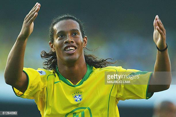 Brazilian Ronaldinho Gaucho celebrates his goal against Bolivia at the Morumbi stadium in Sao Paulo 05 September 2004 for the FIFA World Cup Germany...