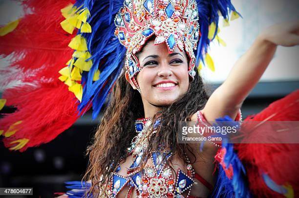 CONTENT] Brazilian samba girl smiles during a public carnival event
