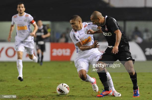 Brazilian Santos player Adriano Bispo vies for the ball with Emerson Shiek of Brazilian's Corinthians during their Copa Libertadores football...