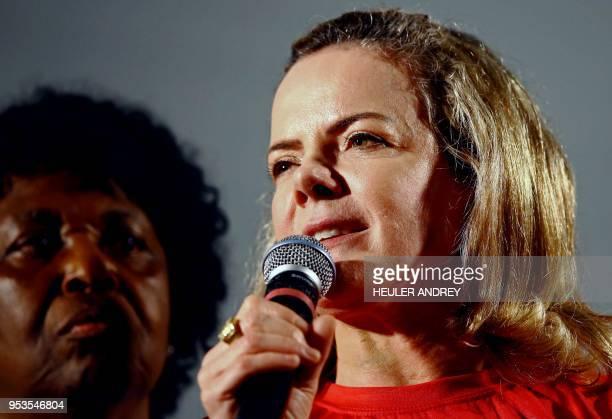 Brazilian senator and president of the Workers' Party Gleisi Hoffmann addresses supporters of Brazilian expresident Luiz Inacio Lula da Silva during...