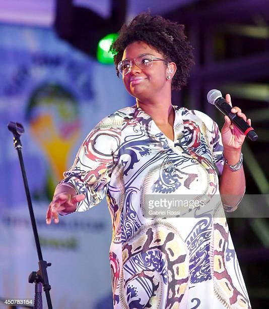 Brazilian singer and composer Ellen OlŽria performs after the Group A Match between Brazil and Mexico at the FIFA Fan Fest at Taguatinga on June 17...