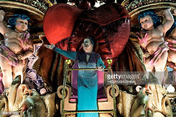 Brazilian singer Beth Carvalho of Mangueira samba school waves during the second night of the carnival parade at Sambadrome in Rio de Janeiro Brazil...