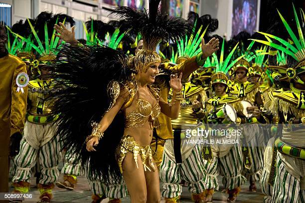 Brazilian singer Claudia Leitte performs in Mocidade de Padre Miguel samba school during the first night of the carnival parade at Sambadrome in Rio...