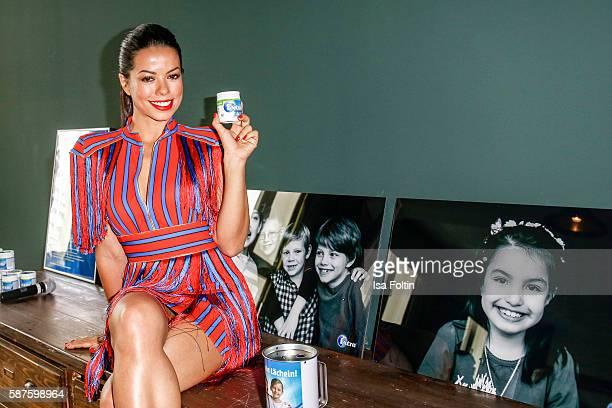 Brazilian singer Fernanda Brandao attends the photo exhibition 'Die Kunst des Kinderlaechelns' by Peter Badge on August 9 2016 in Berlin Germany...