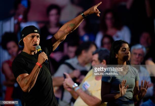 Brazilian singer Mano Brown speaks during the Brazilian presidential candidate for the Workers Party Fernando Haddad campaign rally in Rio de Janeiro...
