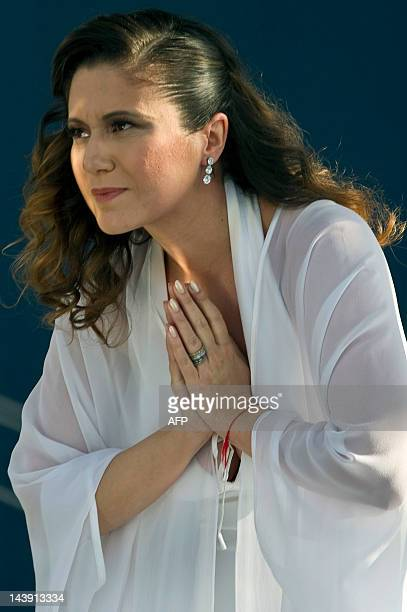 Brazilian singer Maria Rita acknowledges the audience after performing during the Viva Elis project at Parque da Juventude in Sao Paulo Brazil on May...