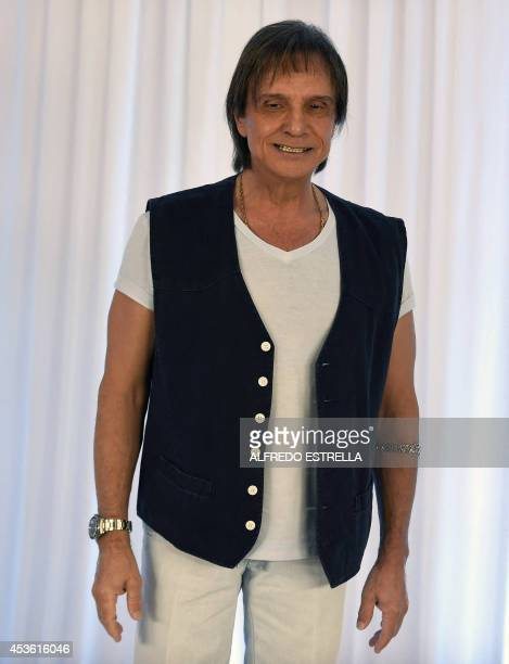 Brazilian singer Roberto Carlos poses for photographers during a photo call before a press conference at the Hyatt Regency Hotel in Mexico City on...