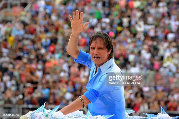 Brazilian singer Roberto Carlos waves from atop a float of the samba school Beija Flor on the Sambadrome in Rio de Janeiro on March 8 2011 on the...