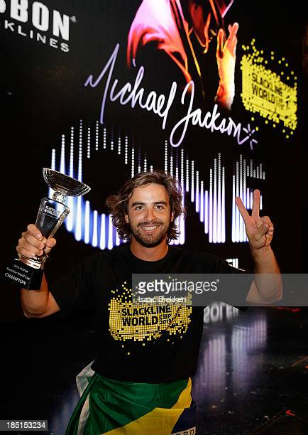 Brazilian slackline athlete Carlos 'Na Fita' Neto poses with a trophy after winning the Slackline World Cup at Mandalay Bay Resort and Casino on...