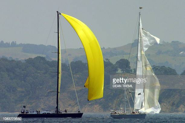 Brazilian sloop Ipanema passes Ulisse of Italy as they run up their headsail after blowing out their spinnaker during the Millennium Cup Auckland 12...