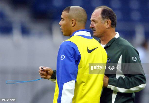 Brazilian soccer coach Luiz Felipe Scolari gives instructions to striker Ronaldo Nazario 24 June 2002 during the training session at Saitama World...