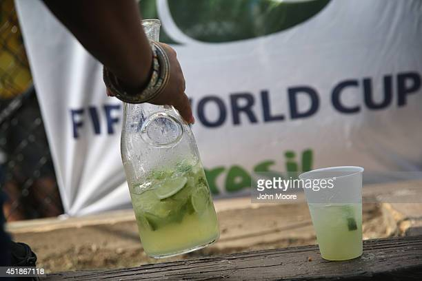 Brazilian soccer fan drinks from a pitcher of caipirinha during the semifinal World Cup game against Germany on July 8 2014 in Port Chester United...