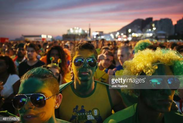 Brazilian soccer fan watch their team play against Cameroon on a screen at the FIFA Fan Fest on Copacabana beach June 23 2014 in Rio de Janeiro Brazil