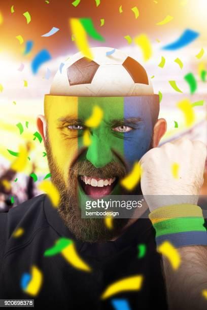 Brazilian soccer fan with football inside the head