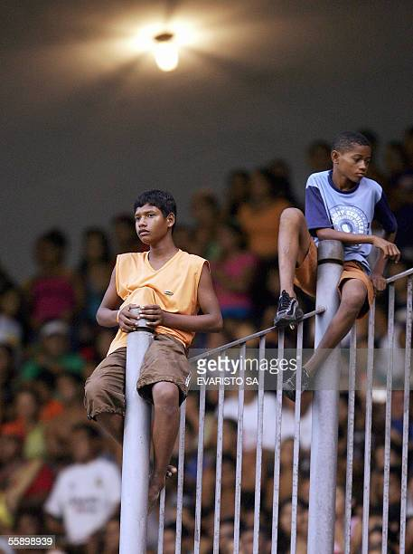 Brazilian soccer fans attend 11 October 2005 the training session of the Brazilian team at Mangueirao stadium in Belem northern Brazil's Brazil's...