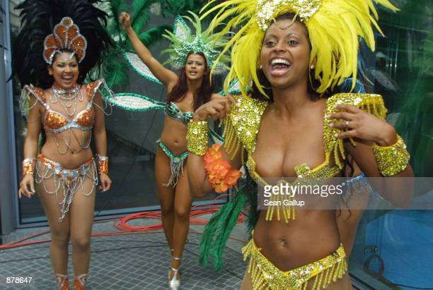 Brazilian soccer fans celebrate Brazil's victory in the World Cup soccer finals after watching the game on a large screen TV June 30 2002 in Berlin...