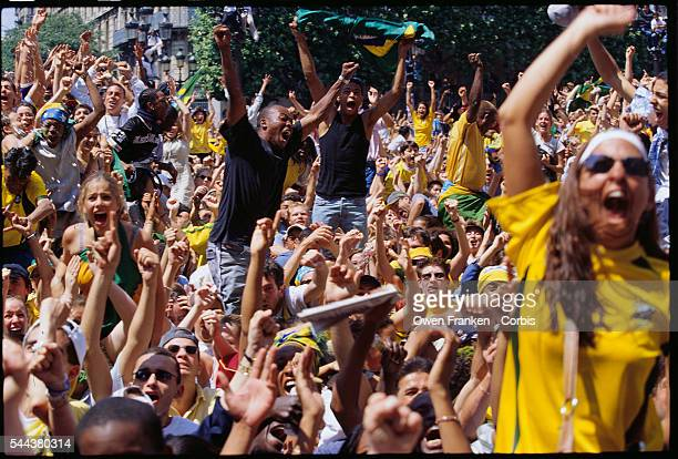 Brazilian soccer fans cheer the 2002 World Cup victory against Germany as they watch a live broadcast in the square outside the Hotel de Ville in...