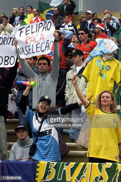 Brazilian soccer fans cheer their team on during a World Cup 2002 KoreaJapan qualifier in Montevideo Uruguay 01 July 2001 Uruguay defeated Brazil 10...