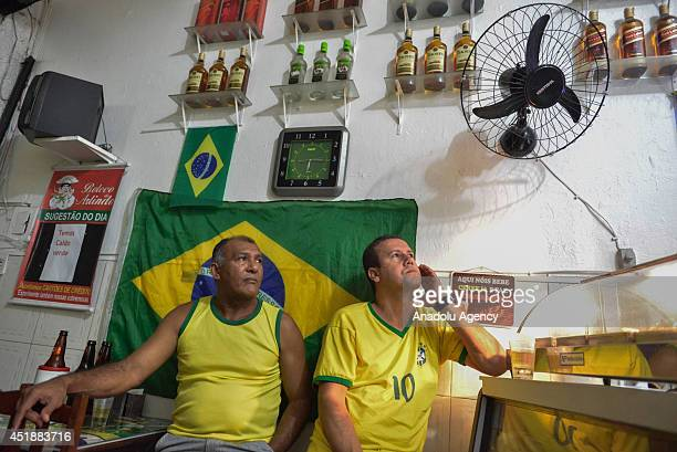 Brazilian soccer fans watching their team against Germany in a Bar in the Favela Rocinha within the FIFA World Cup 2014 July 8 Rio de Janeiro Brazil