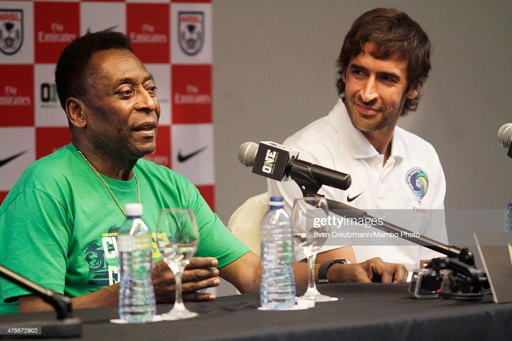 Brazilian soccer legend Pele (L) and New York Cosmos captain Raul Gonzalez Blanco (R) during a press conference in the Melia Cohiba hotel, a day before a friendly soccer match between Cuba and New York Cosmos, on June 1, 2015 in Havana, Cuba. The Cosmos will play against Cuba on June 2, 2015 and is the first professional sports team to visit Cuba since 1999, when the Baltimore Orioles played in Cuba.
