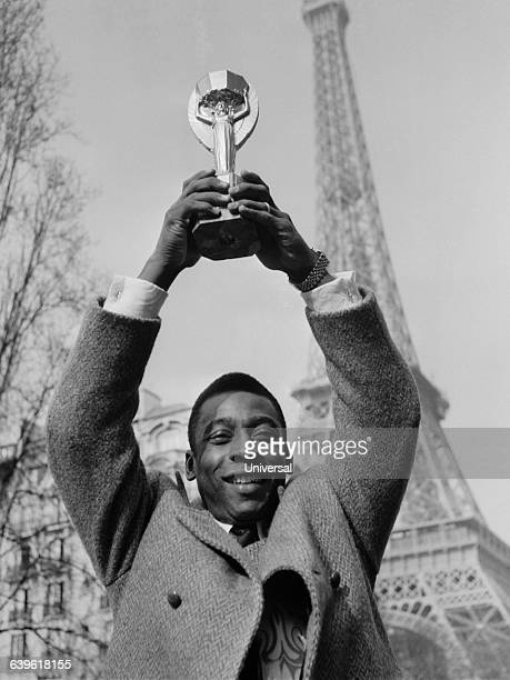 Brazilian soccer legend Pele is in Paris for a friendly match but today he appears in front of the Eiffel Tower holding the FIFA World Cup trophy The...