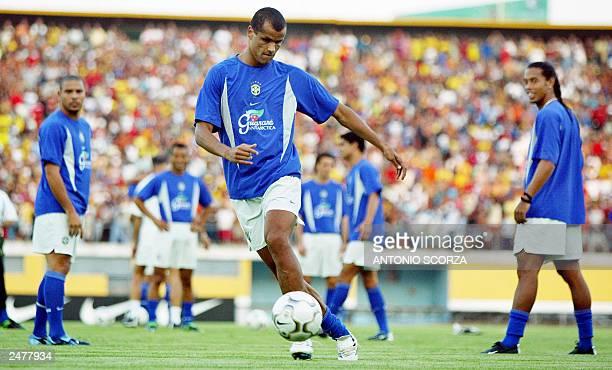 Brazilian soccer midfielder Rivaldo Ferreira controls the ball 09 September 2003 observed by Ronaldo Nazario and Ronaldinho Gaucho during the...