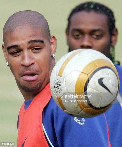 Brazilian soccer player Adriano Ribeiro of Italian team Internazionale looks at the ball while teammate Vagner Love watches him 20 July 2004 during a...