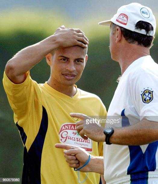 Brazilian soccer player Alex also player of the Italian team Parma listens to his coach Luiz Felipe Scolari 21 July 2001 during a training session in...